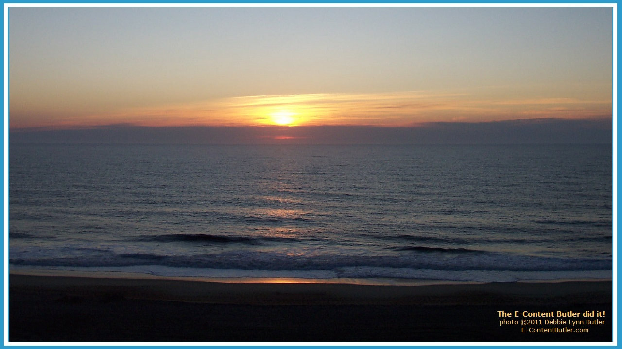 sunrise over the ocean as a new day begins by Debbie Lynn Butler, the E-Content Butler